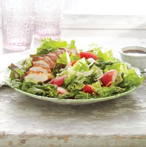 This Arugula Salad with Parmesan-Crusted Chicken, Asparagus and Strawberries looks so fancy but it's easy to make. Just bread the chicken and toss with arugula, asparagus and strawberries. Nothing tastes more like spring.