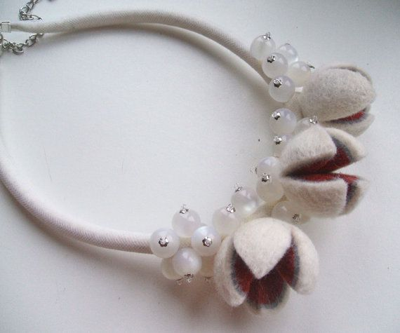 Necklace is made from merino wool, beads and silver colored fittings. The necklace is White . The nuts are decorated with burgundy and grey colors wool. There are wool in the nylon tube around the neck. Necklace is about 47 cm (18,5 ) long without chain that regulates the length. Shipping: