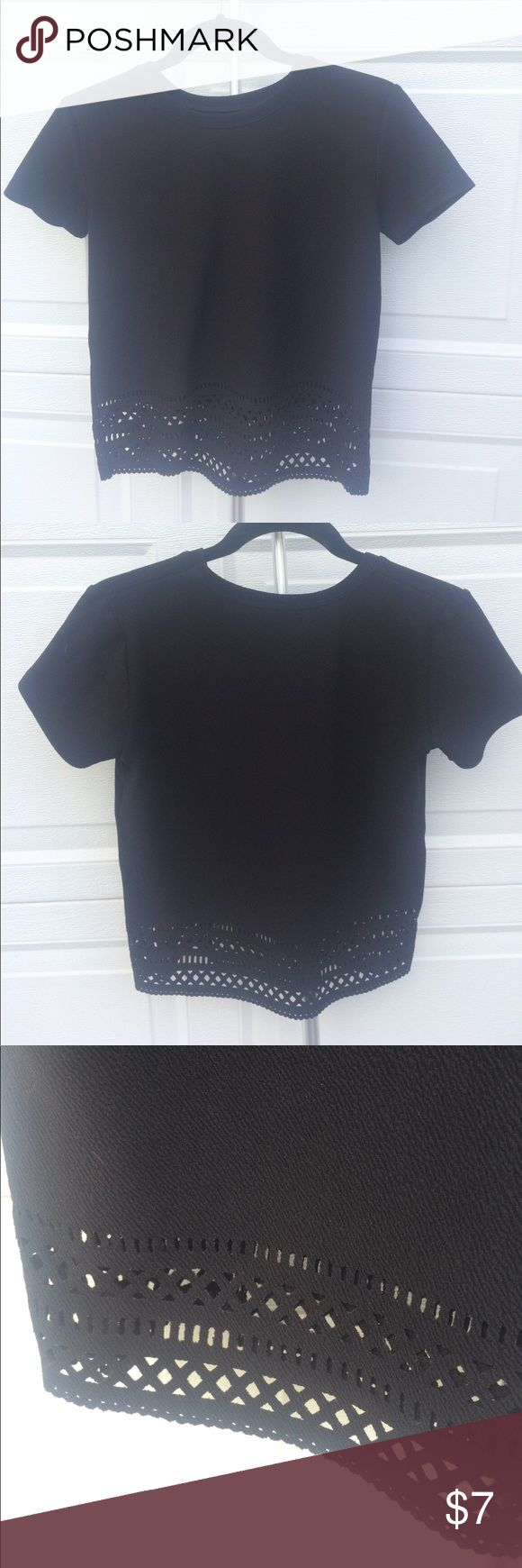 Black Short Sleeve Top 100% polyester. Size M, doesn't have a tag with the size but I wear size medium and it fits great. Has a nice stretch to it as well. Bottom has a beautiful pattern. Super comfortable t-shirt style with a nicer feel. Shirt is a shorter style. Buru Tops
