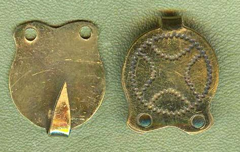 """These beautiful Winingas hooks are copied from an original in our private collection. They are cut from sheet brass and engraved with a wiggle-work pattern. The original was discovered near York, England and would have been used to secure the leg windings of a Viking or a Saxon. They are 1"""" long by 3/4"""" wide.  $12.00 per pair."""
