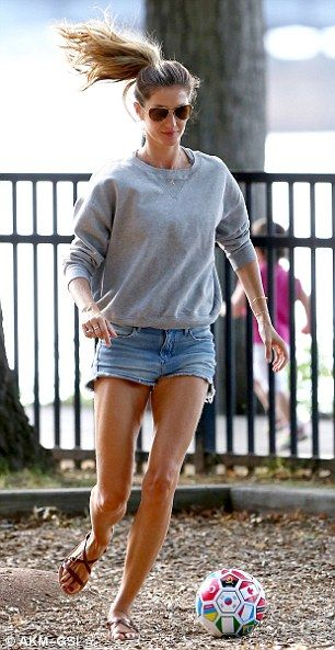 Fun mom: Gisele didn't let her flimsy sandals keep her from playing soccer with her husban...