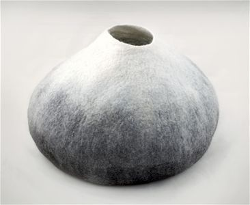 White/Black Pod Vessel by Deborah Roberts  Handmade felt made using a resist technique to create a void seamless shape which then manipulated and shaped by hand using a technique developed by the maker.