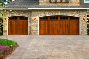 Pavers, custom doors, and stone on upscale home. - jim krugerE+/Getty Images