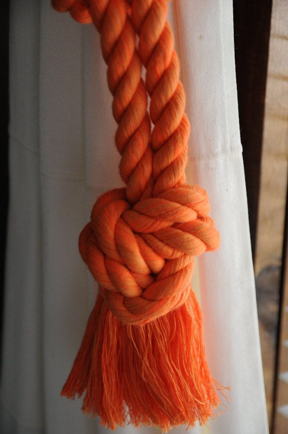 Handmade I made these nautical curtain tie backs using 1/2 inch diameter cotton rope. It is orange in color. I can make them as long as you need, I find that a 20 inch loop works the best on most curtains, not too tight and not too loose. If you need them longer just let me know. This is one