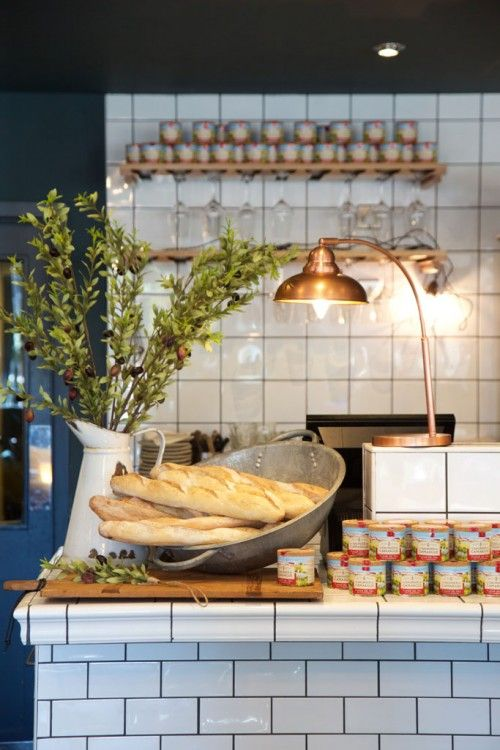 Brasserie Blanc Chichester. Stunning chees, counter; white  subway tile with dark grout, copper table lamp
