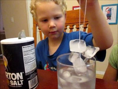 Fishing For Ice. All you need is salt, water, ice, and string! #kidscience #scienceexperiment ScienceKiddo.com