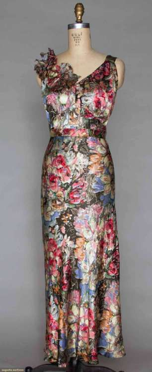PRINTED LAME EVENING GOWN, 1930s gold brocade florals over multi color floral bouquets printed on black silk charmeuse