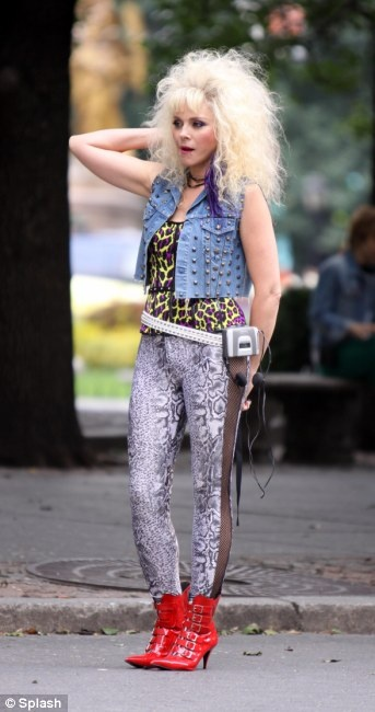 Kim Cattrall pictured wearing a 80's costume on the set of the
