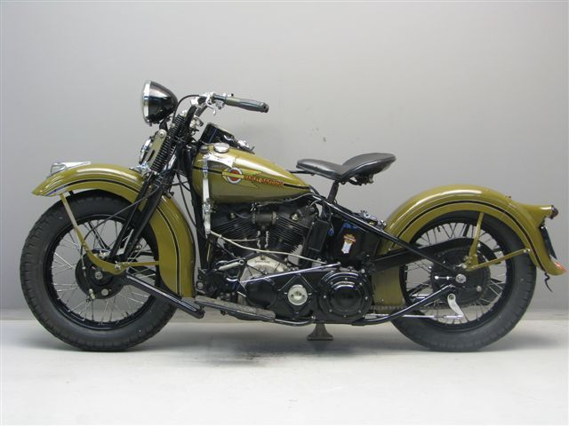 Harley Davidson 1938 knucklehead. Skinny jeans, white v neck, brown bomber jacket and my gold aviators. I can already see it.