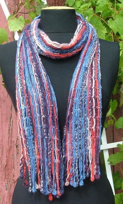 crochet scarf (I see it more as a wrap...) made out of rows of 8 ch, 1 sc, 8ch, 1sc... You choose the length and the width!!! easy peasy!!!