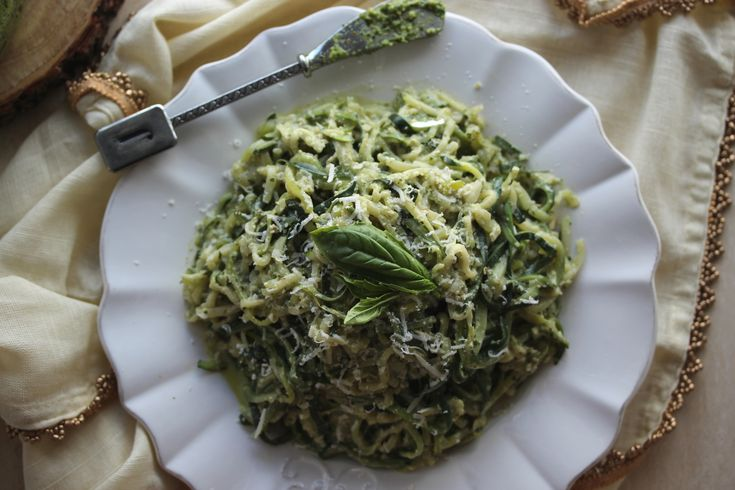 Zucchini noodles tossed in a rich and creamy walnut pesto topped with fresh parmesan. A low-carb, vegetarian, gluten-free meal that is undeniably delicious and satisfying. Yes, I am eating entire plates of vegetables to off-set the amount of Christmas cookies I have... #lowsugar #pasta #pesto