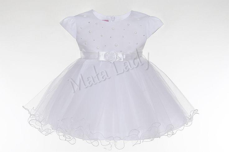 Wyjątkowa sukienka Klara z tiulem w kolorze białym. Odszyta płótnem bawełnianym oraz podszewką. Cudnie udekorowana mieniącymi się cyrkoniami oraz perełkami. Sukienka posiada kryty zamek oraz rękawki typu motylek. Sukienka Klara dostępna jest również w kolorze ecru oraz różowym. Sukienka dostępna również w rozmiarach 92-152.