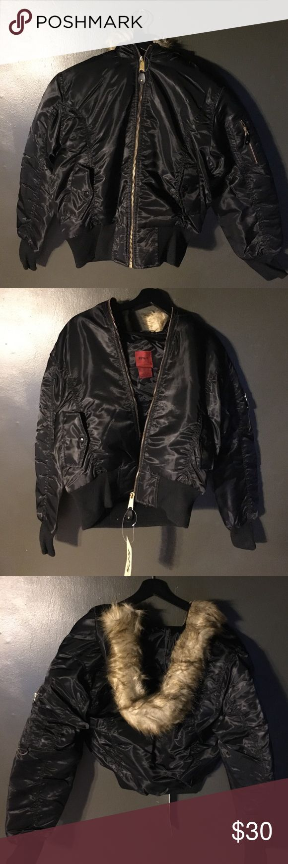 Black and Red women's bomber jacket w/ fur hoods Selling two different bomber jackets in black and red. They have fur hoods and a zipper detail on the right arm. They are both fully lined. In the black, I have 1 small and 1 medium. I have several red bombers that range from small to extra large. They are NWT. Jackets & Coats Puffers