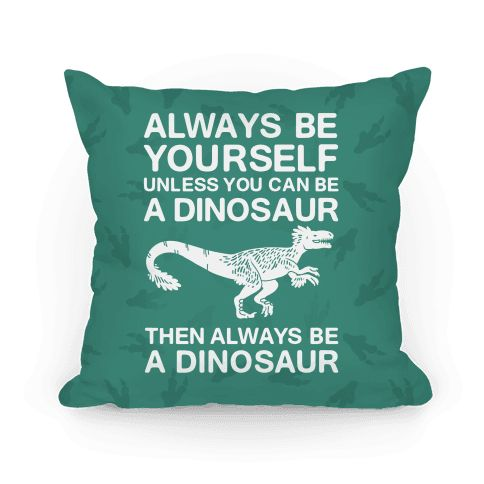 Being yourself is good, but being a dinosaur is better. All claws, all teeth, no problems at all! Well, except maybe food. Aspire high, aspire to be your best self, but as a dinosaur. Be inspired to love yourself and be a dinosaur with this great inspirational pillow design. | HUMAN