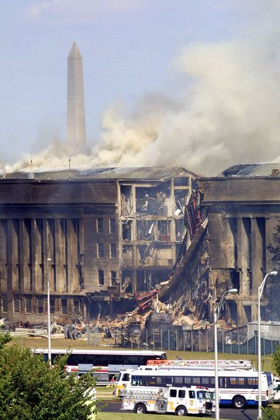 Smoke comes out from the west wing of the Pentagon building September 11, 2001 in Arlington, Va., after a plane crashed into the building and set off a huge explosion.