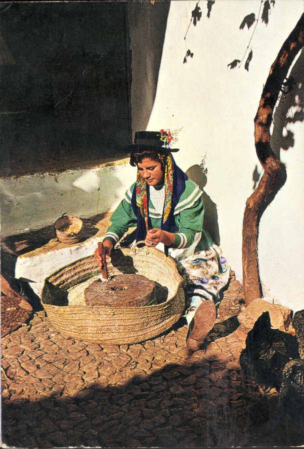 Woman using a millstone, Portugal Algarve