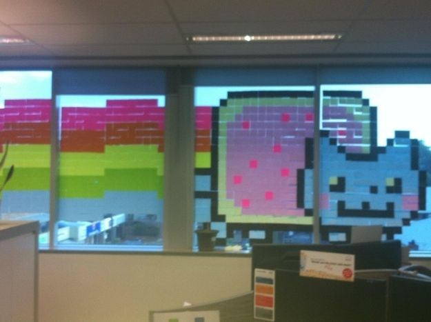 Make a giant Nyan cat mural out of colored paper. | 27 Pointless Projects To Do When You're Bored At Work
