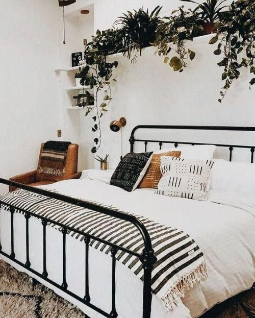 Black bed with a lot of green white walls and wood. Scandinavian interior Nordic interior ideas for the home office workspace Sc ...