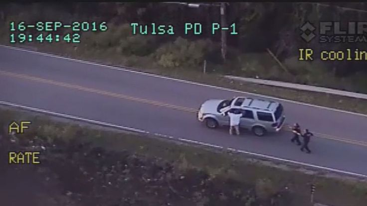 Man Killed by Tulsa Cop Had Hands Up Before Shooting -      The Tulsa Police Department released video showing that a 40-year-old black man who was killed by a white officer Friday night had his hands up i...