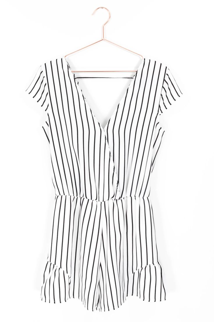 Simplistic vertical striped romper with short cap sleeves, a flattering V neckline and back. Hidden snap button closure on neckline to wear open or closed. Non-stretch woven semi-sheer material, worn