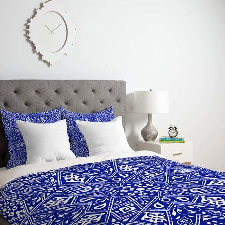 Showcasing a geometric motif in blue, this eye-catching duvet cover brings a pop of pattern to both neutral and eclectic bedroom decor.