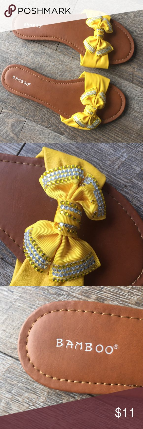 Bamboo yellow flip flops with bling bow 81/2 By the brand bamboo, women's flip flops in a size 81/2. Features a big yellow bow with bling on it. These are perfect with a floral blouse for spring.  These are in great condition. Has some minor missing beads but aren't noticeable unless you look really close. BAMBOO Shoes Sandals
