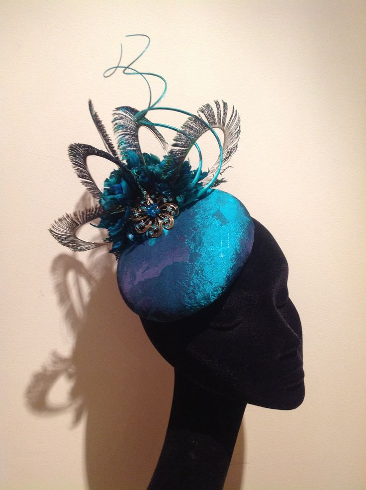 Teal headpiece with peacock feathers and crystal details