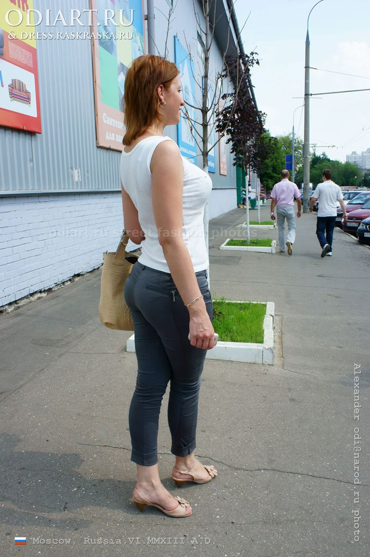 Russian Woman In Tight Graphite-colored Pants. Summer