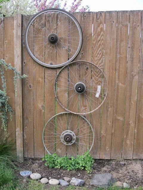 Bicycle wheels in the garden - love this idea....