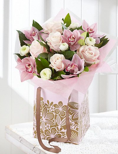 A gorgeous array of blooms, part exotic, part traditional presented in a gift bag make the most wonderful treat for mothers day. #MarksAndSpencers #MothersDay