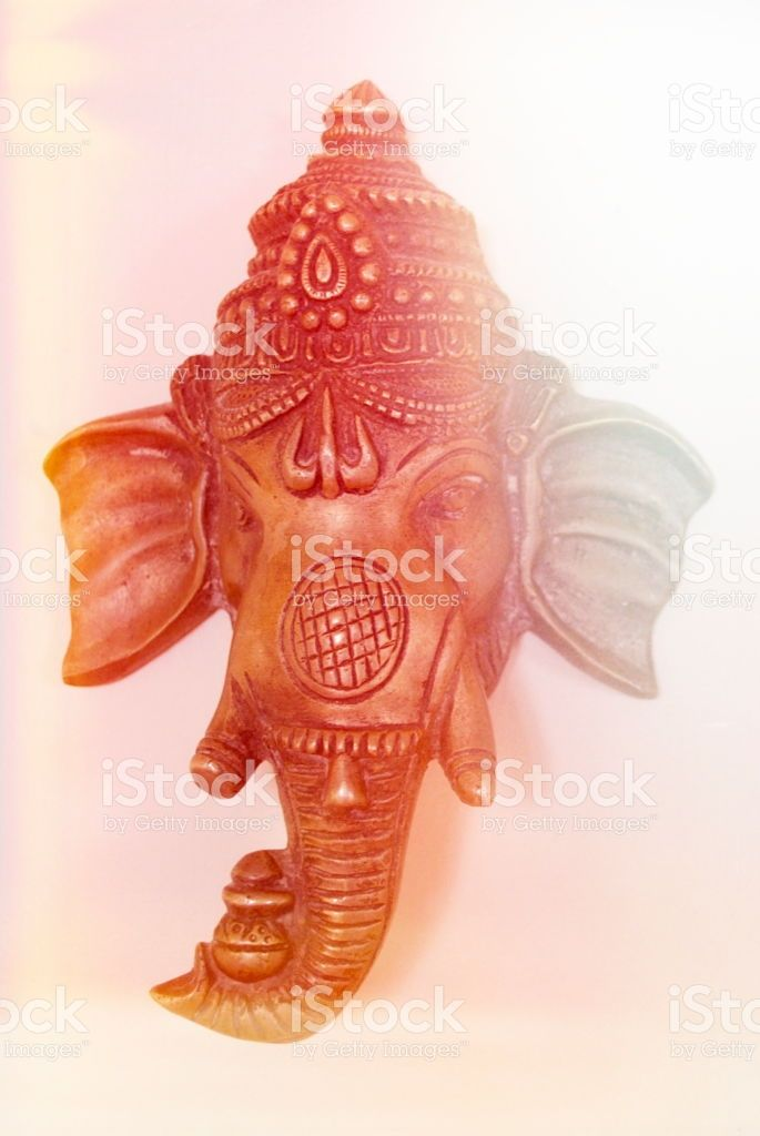 Brass Mask of Indian God Ganesha with Solar Flare royalty-free stock photo