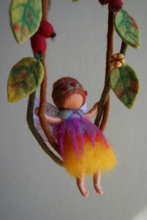 Love the softness, and carefree look of this little doll and the felted leaves.