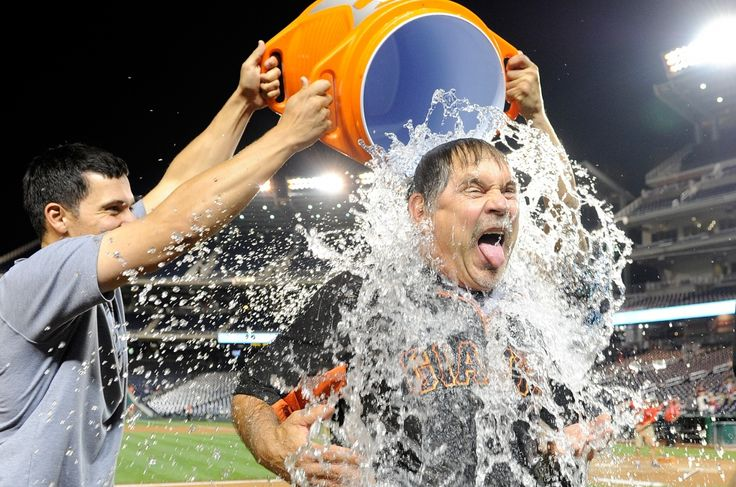 SAN FRANCISCO GIANTS: THE SPLASH The best photos of the 2014 San Francisco Giants - Manager Bruce Bochy takes the ALS Ice Bucket Challenge after the game against the Washington Nationals on August 22.