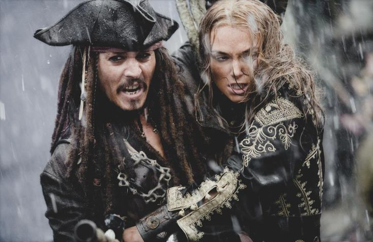 PIRATES OF THE CARIBBEAN  AT WORLD'S END Disney Studios  Johnny Depp and Keira Knightly in Battle in the Rain (talk magazine)