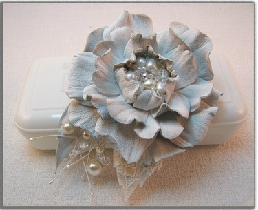 Handcrafted leather rose in white on DaWanda.  (accessories, brooches, clips)  http://en.dawanda.com/product/40581938-Leather-flower-hair-clips-and-brooch-2x1-