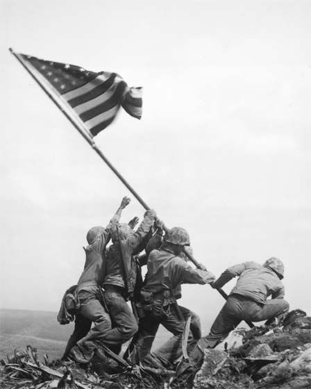 Title:	Marines of the 28th Regiment of the 5th Division Raise the American Flag Atop Mt. Suribachi, Iwo Jima, 1945  Artist:	Joe Rosenthal