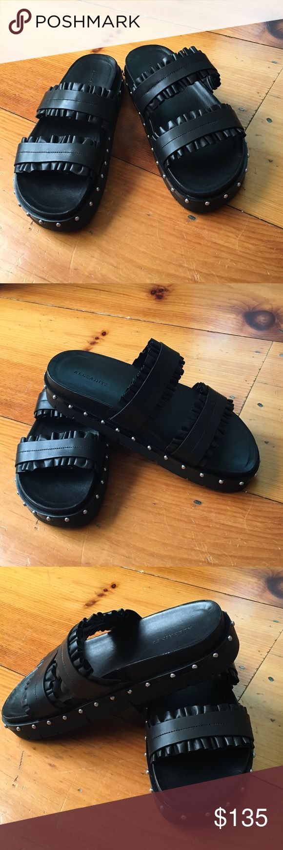 """ALLSAINTS Alanna Ruffle Studded Slide Sandals ALLSAINTS Alanna Ruffle Studded Slide Sandals in Black! US Size 7  - Fits True to Size. Open Toe Slip On. Leather Ruffle Detail at Straps. Stud Detail at Sole. Molded Footbed. 1.5"""" Platform? Leather Upper & Lining, Rubber Sole. Brand New! All Saints Shoes Sandals"""