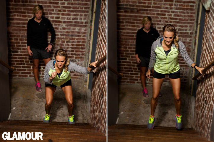 Carrie Underwood's Leg Workout: Stair Squat and Jump  hand. Lower into a squat, extending your hips back, keeping your knees over your toes,...