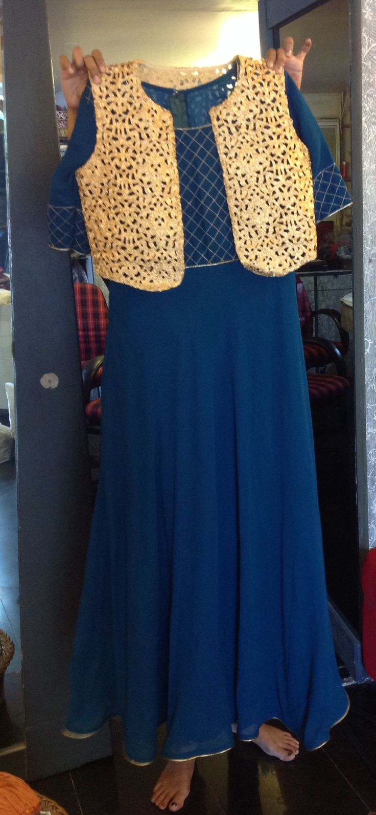 Blue anarkali with gold cutwork jacket....