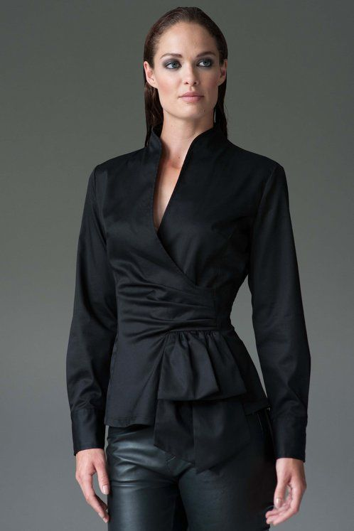 Inspired by a 1950's silhouette this modern classic shirt has a nipped-in waist, plunge neckline and peplum. A feminine shirt ideal for work and off-duty.  Also available in White.  Black Also available in White Shirt with diamonte butons on each cuff. Invisible zipper on one side. Body length: sizes 8 - 12: 61.5-62.5 cm, 14 – 18: 63-64 cm Italian fabric: 95% cotton, 5% elastane Machine wash $142.01 USD by The Shirt Company
