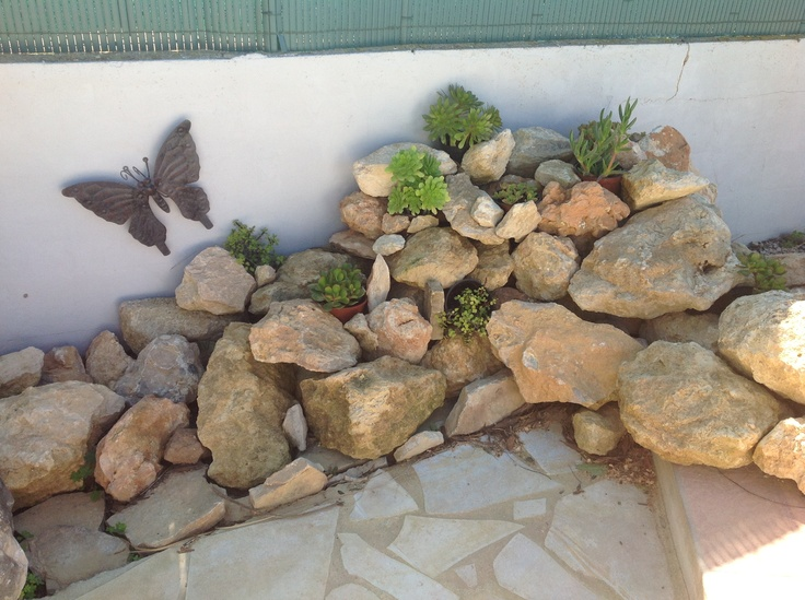 Original Spanish lava stones, used as a decoration along the pool.  Equiped with plants which don't need to be watered in the summertime.