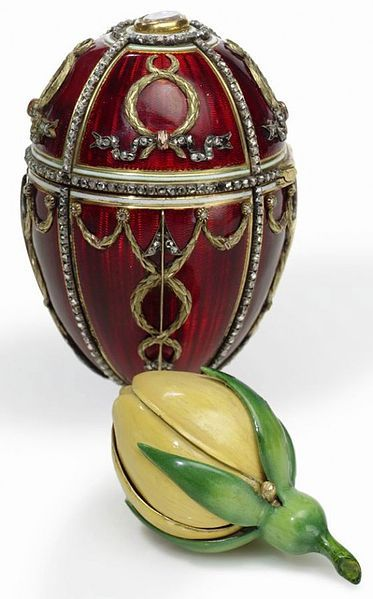 FABERGÉ~ ROSEBUD EGG~ 1895. Imperial Fabergé Egg No. 11. A gift from Tsar Nicholas II to Empress Alexandra Feodorovna. The surprise is a yellow enamelled rosebud, which originally contained two more surprises: a diamond replica of the Imperial crown with a cabochon ruby pendant suspended inside. The crown and pendant have been lost.