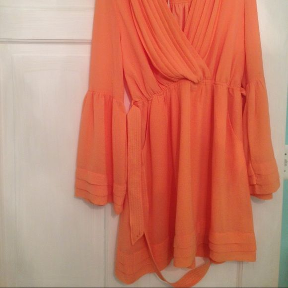I just discovered this while shopping on Poshmark: Tangerine Dress- Mint Julep BoutiqueNWT. Check it out!  Size: M