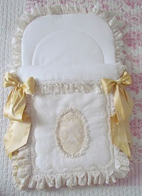 Baby nest with silk bows and a bit of yellow lace.