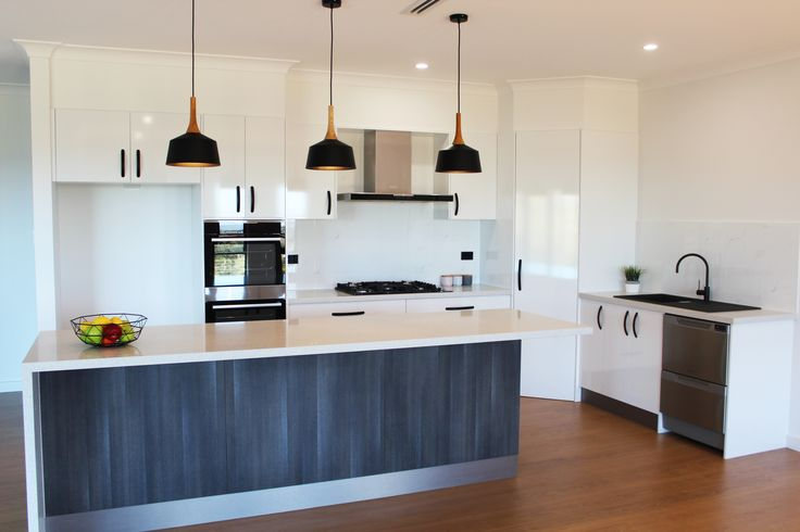 Snowdrift Gloss doors, Trend Surfaces White star benchtops paired with black fittings.