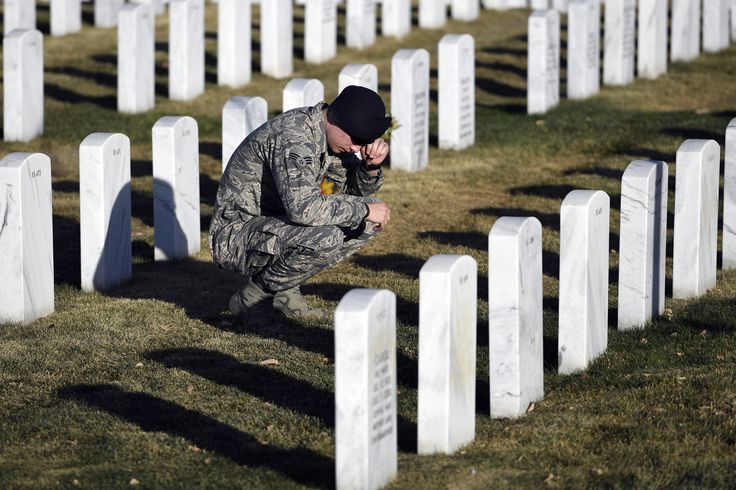 Glen Newton 24-years-old, Air Force wipes a tear as he kneels down to visit his grandfather at Ft. Logan National Cemetery November 11, 2016 on Veterans Day. His grandfather, Joe Bolton was a Capt. in the US Army, Vietnam. Bolton passed October 26, 2016. (Photo By John Leyba/The Denver Post via Getty Images)  via @AOL_Lifestyle Read more: http://www.aol.com/article/news/2016/11/11/here-s-how-america-is-celebrating-veterans-day/21604375/?a_dgi=aolshare_pinterest#fullscreen