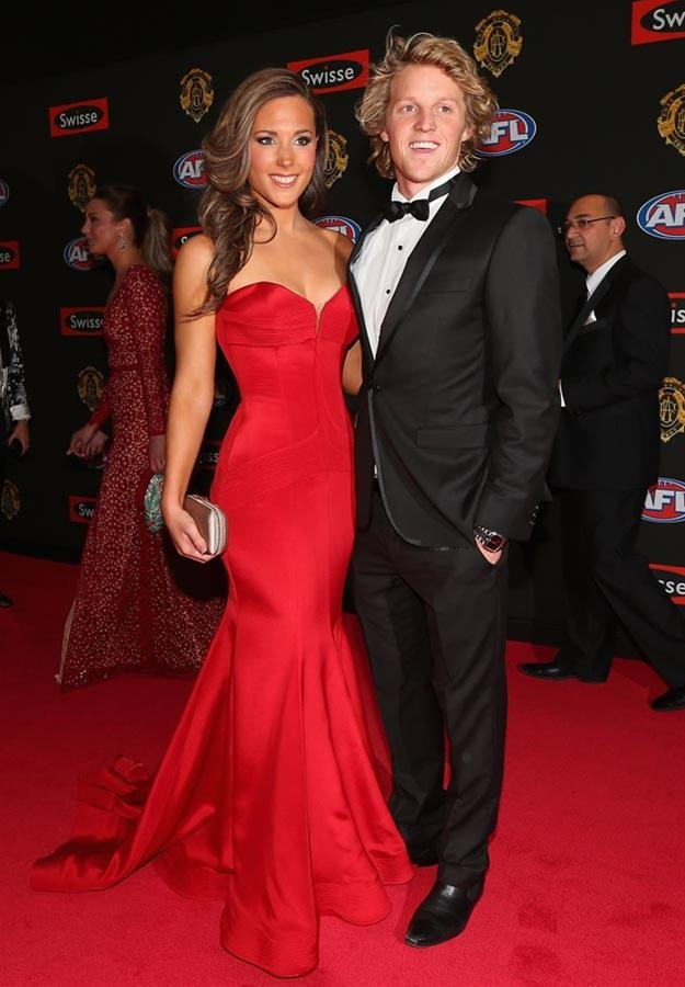 Belinda Riverso wearing Julie Simonelli at the 2012 Brownlow Medal (pictured with Rory Sloane)
