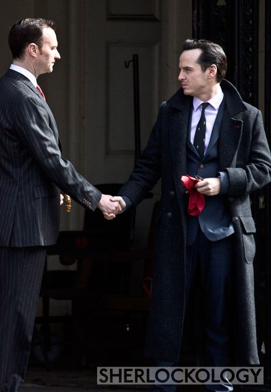Mycroft Holmes (Mark Gatiss) and James Moriarty (Andrew Scott) - This photo just confuses me to no end, because this does not look like Mark and Andrew interacting while in costume. This is Mycroft and Moriarty shaking hands.<-they are plotting together