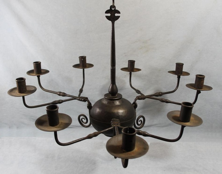 We have a large variety of early and fine lighting fixtures at our shop,  including - Antique Candle Chandelier Antique Furniture