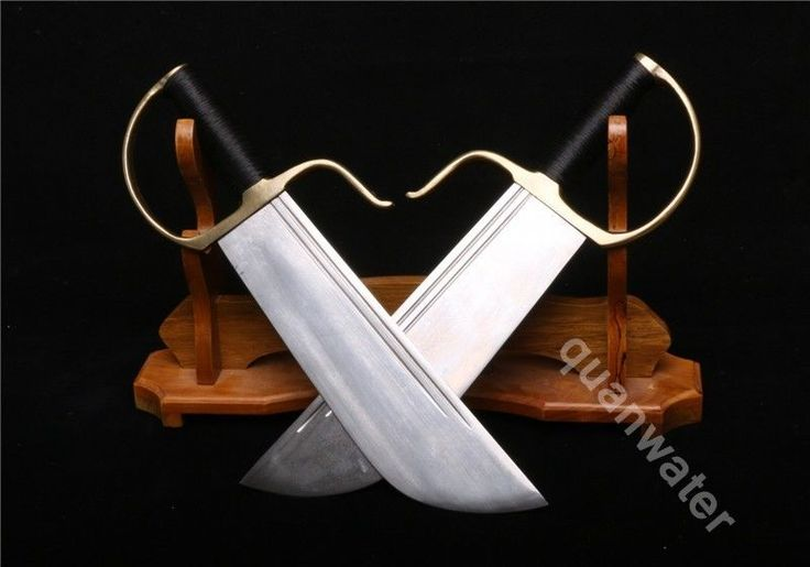A PAIR OF FOLDED STEEL BLADE COPPER HANDLE SWORDS CALLED BUTTERFLY SWORDS ()